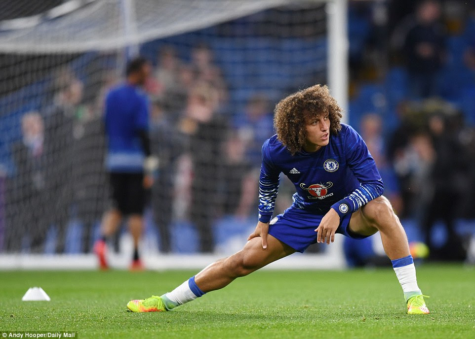 Cult hero Luiz warms up ahead of making his second Chelsea debut after returning from PSG for £30m