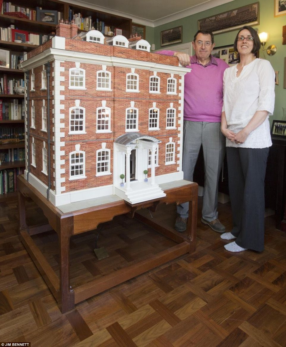 Labour of love: Geoffrey Walkley and his daughter Sarah with the incredible doll's house that took 35 years to build