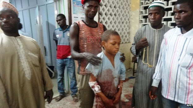 A young boy injured in the mosque attack arrives at local hospital