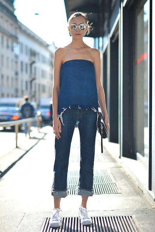 Le Fashion Blog Street Style All Denim Look White Mirrored Sunglasses Strapless Top Raw Hem Boyfriend Jeans White Sneakers Via Stylecaster