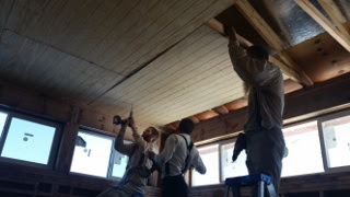 Putting Up Ceiling Panels in the House Library