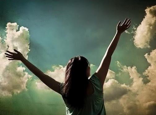 [Photo of a woman with hands lifted in praise]