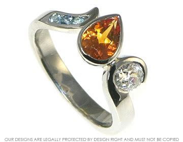 Fire and Ice inspired aquamarine and diamond engagement ring