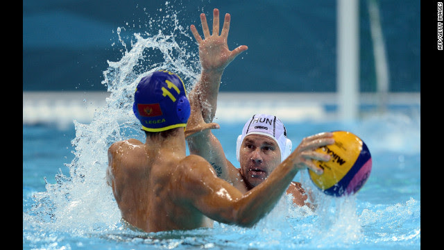 Hungary's Peter Biros, right, challenges Montenegro's Vladimir Gojkovic during the men's water polo preliminary match Tuesday.