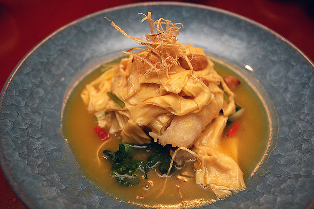 Simmered Fillet of Star Garoupa with Beancurd Skin and Wolfberries in Carrot Broth