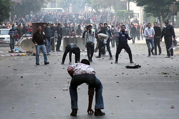 Cairo protest: Muslim Brotherhood supporters (backgroun