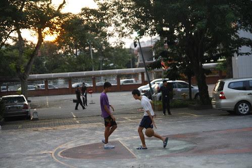 Kids playing basketball at Chung Hwa High School