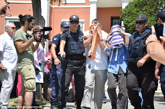 Eight other military personnel who flew a helicopter to Greece amid the coup have tried to claim asylum in the country. One is pictured being led into a court in the Greek city of Alexandroupolis