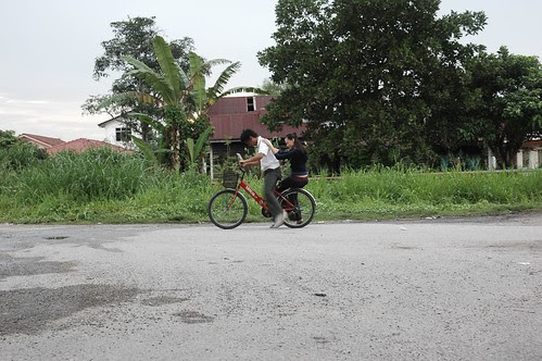 Ali giving Miss Carol a ride on his bicycle