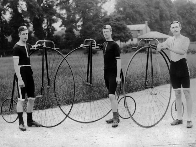 Three men stand with their penny farthing bicycles. Follow their example for Bike to Work Day, and take a photo of yourself and your bike. Then, post the photo to Twitter or Instagram, with the hashtag #NPRbike.