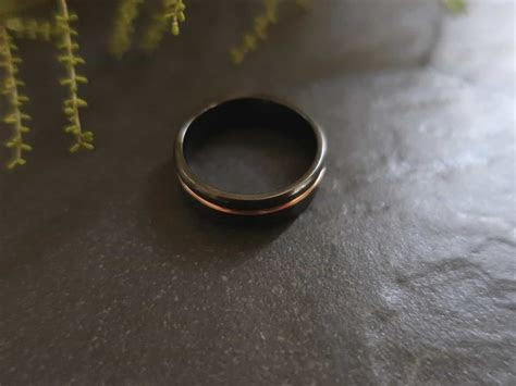 black zirconium wedding band  rose gold stripe black