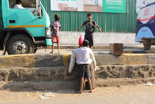 Street Children Making The Old Man Of 2012 by firoze shakir photographerno1