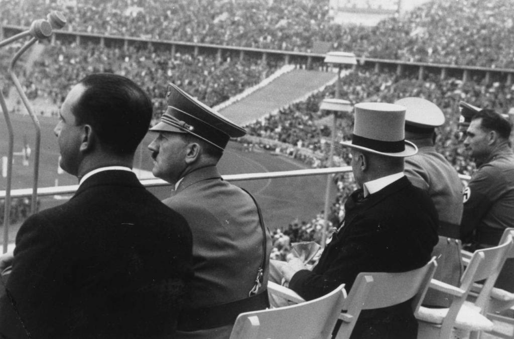 Adolf Hitler watching the Olympic Games in Berlin with the Italian Crown Prince, August, 1936. (Fox Photos/Getty Images)