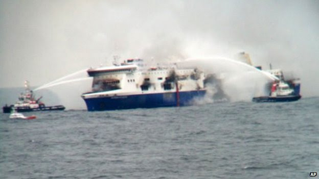 Vessels try to extinguish the fire at the Italian-flagged Norman Atlantic after it caught fire in the Adriatic Sea, on 28 December 2014