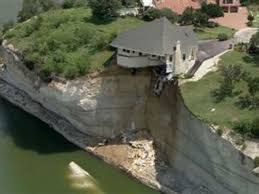 House falling off cliff at Lake Whitney