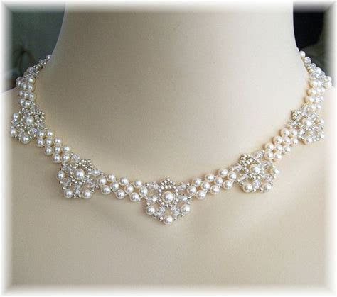 Ivory Swarovski Pearls, silver seed beads and clear