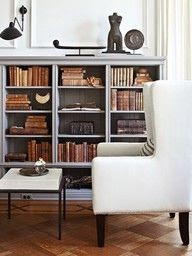 low bookshelf and wingback chair