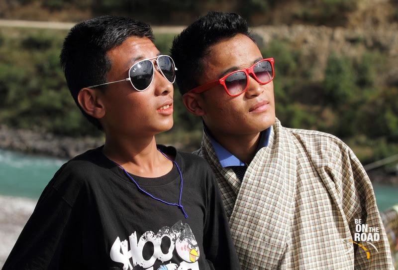 2 Bhutanese boys and their colourful sunglasses