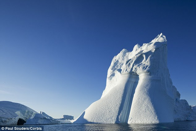 A new scientific paper has warned that melting of ice sheets in West Antarctica and Greenland may be happening 10 times faster than was previously predicted. This could lead to sea levels rise of up to 30 feet within 50 years, they warn. A picture of an iceberg which calved off from the Greenland ice sheet is pictured