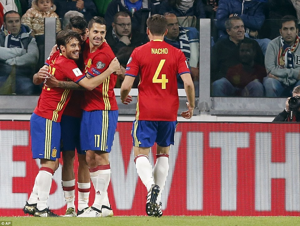 Silva and Costa embrace Vitolo as Nacho joins the celebrations after the opening goal on 55minutes