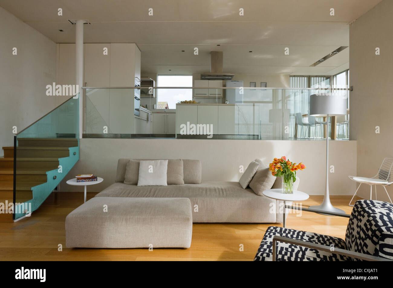 Split-level open plan living room and kitchen Stock Photo ...