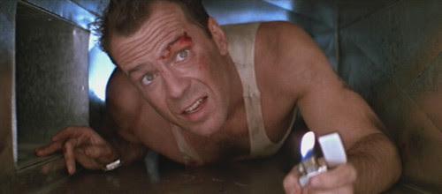 John McClane (Bruce Willis) in a tight spot