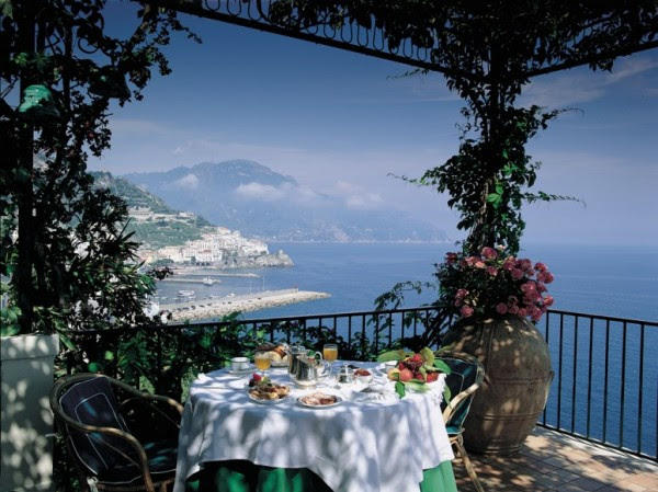 brunch in dappled sunlight on terrace with coastal views