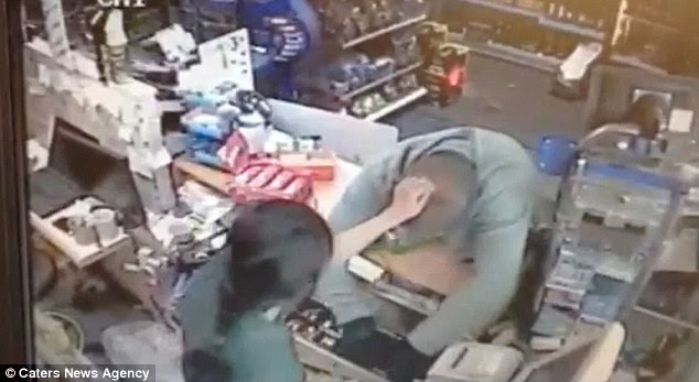 Struggle: Rasika Yakanwala grapples with Manny Buckland as he tries to rob the till she is working at