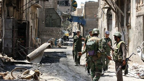 Syrian military forces patrolling the city of Allepo. The United States, Europe and their agents are backing the war against the Middle Eastern nation. by Pan-African News Wire File Photos