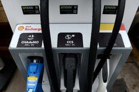 FILE PHOTO: Electric car chargers are seen at the Holloway Road Shell station where Shell is launching its first fast electric vehicle charging station in London, Britain October 18, 2017. REUTERS/Mary Turner/File Photo