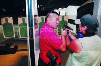 D.V. Ing, a concealed handgun license instructor, gave some pointers to state Rep. Vicki Truitt during a recent class in Fort Worth.