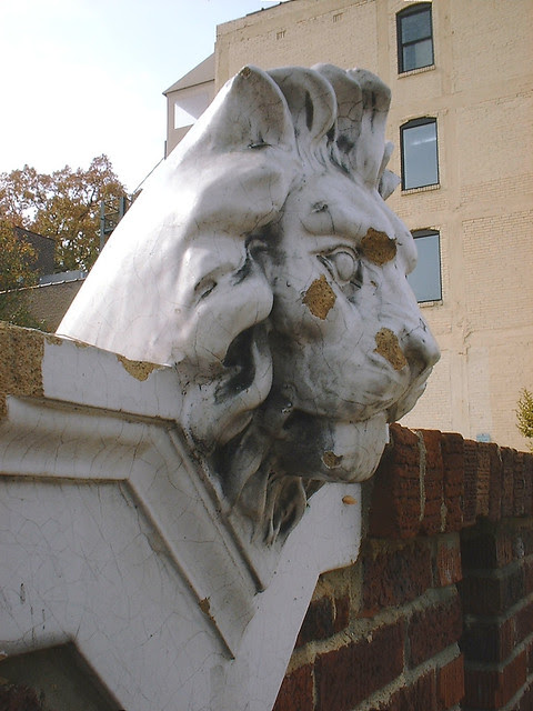 lion on brick wall