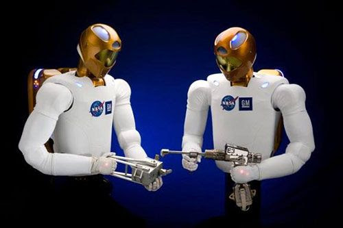 There's something disconcerting about the way these robots are holding those tools.  BLASTERS!