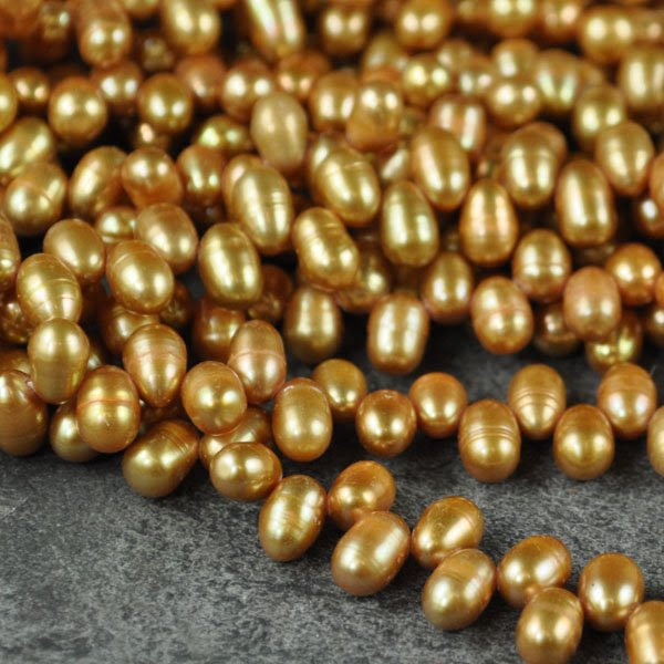 s33779 Freshwater Pearls - 7 mm Top Drill Bullet Pearl - Gold (strand)