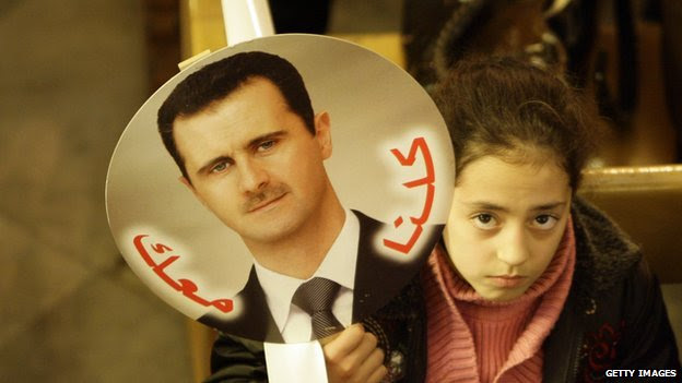 Girl with a picture of President Bashar al-Assad