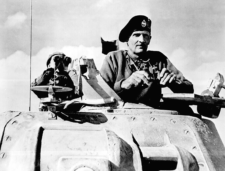 File:Montgomery watches his tanks move up.jpg