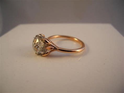Vine solitaire by David Klass Jewelry.   Solitaire Rings