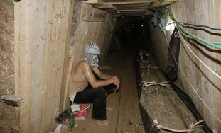 Palestinian sits in Egypt-Gaza smuggling tunnel
