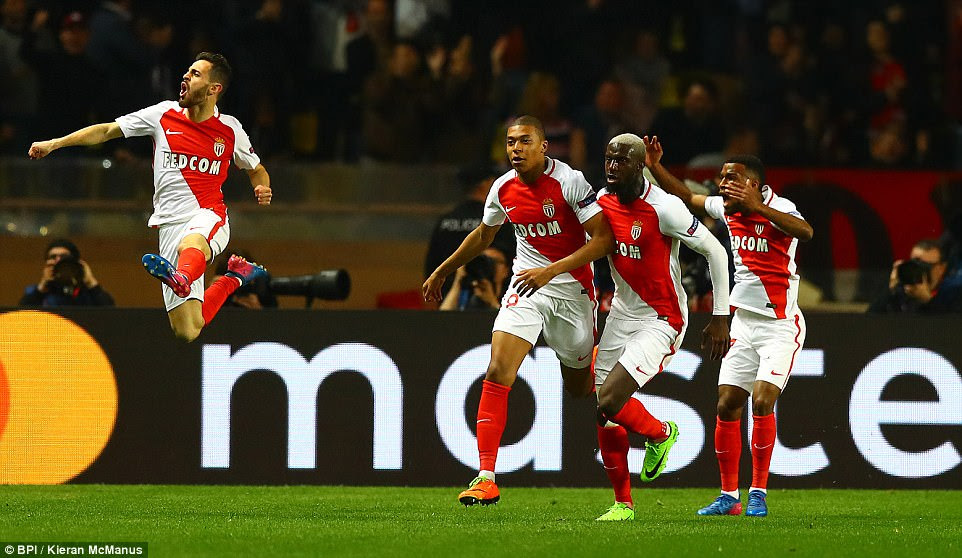 Bernardo Silva leaps into the air as Monaco's players react in delight after Mbappe's eighth-minute Champions League opener