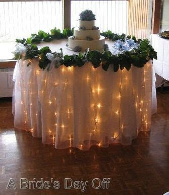 wedding lights ideas   Wedding Cake Table by A Brides Day