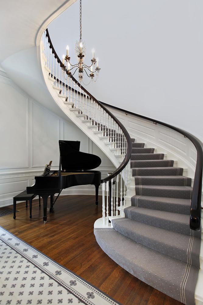 wavy entry way with chandelier - Interior Design Ideas