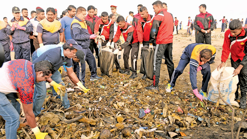 ARMY BEACH CLEAN-UP CAMPAIGN: The Army taking the lead to make waste-free beaches in Sri Lanka yesterday organized an island wide beach cleaning campaign. Army Commander Lt.Gen.Shavendra Silva participated at the commencement of the programme at Crow Island in Modara. Picture by Rukmal Gamage