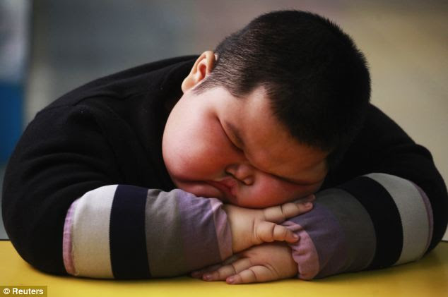 Nap time: After having his energy sapped from a busy morning at kindergarten, Hao takes takes a snooze