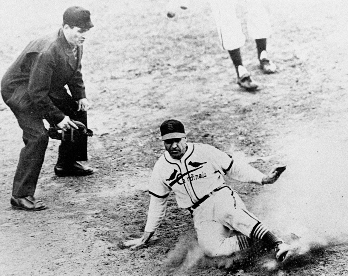 """Boston shortstop Johnny Pesky hesitated before throwing home, and Enos Slaughter scored all the way from first base on an eighth-inning double by Harry """"The Hat"""" Walker to give the Cards a 4-3 victory."""