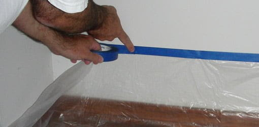 Cover floor with plastic before spraying ceiling, and secure to walls with painter's tape