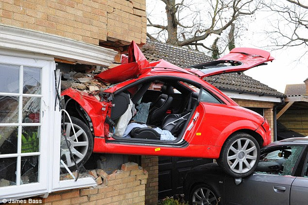 Lucky to be alive: Lewis Richardson suffered horrific head injuries and was left fighting for his life after he rammed the red sports car into the side of this house