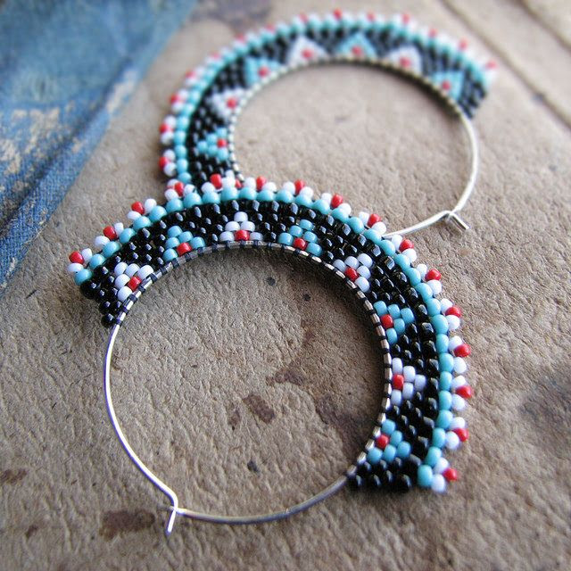 Red white and black beaded hoops by Sylvia Windhurst, via Flickr