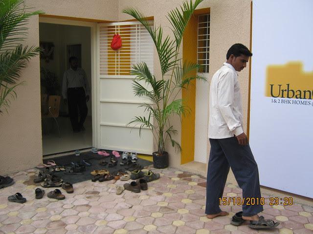 Footwear at the door of the sample flat at Vastushodh's UrbanGram at Kondhawe Dhawade near Warje in Pune