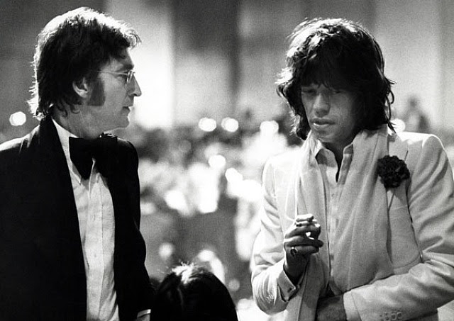 Ron Galella, John Lennon, Mick Jagger, and May Pang attend the AFI Salute to James Cagney at the Century Plaza Hotel, Los Angeles, CA, March 13, 1974