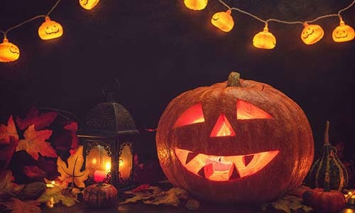 carved pumpkin and Halloween lights